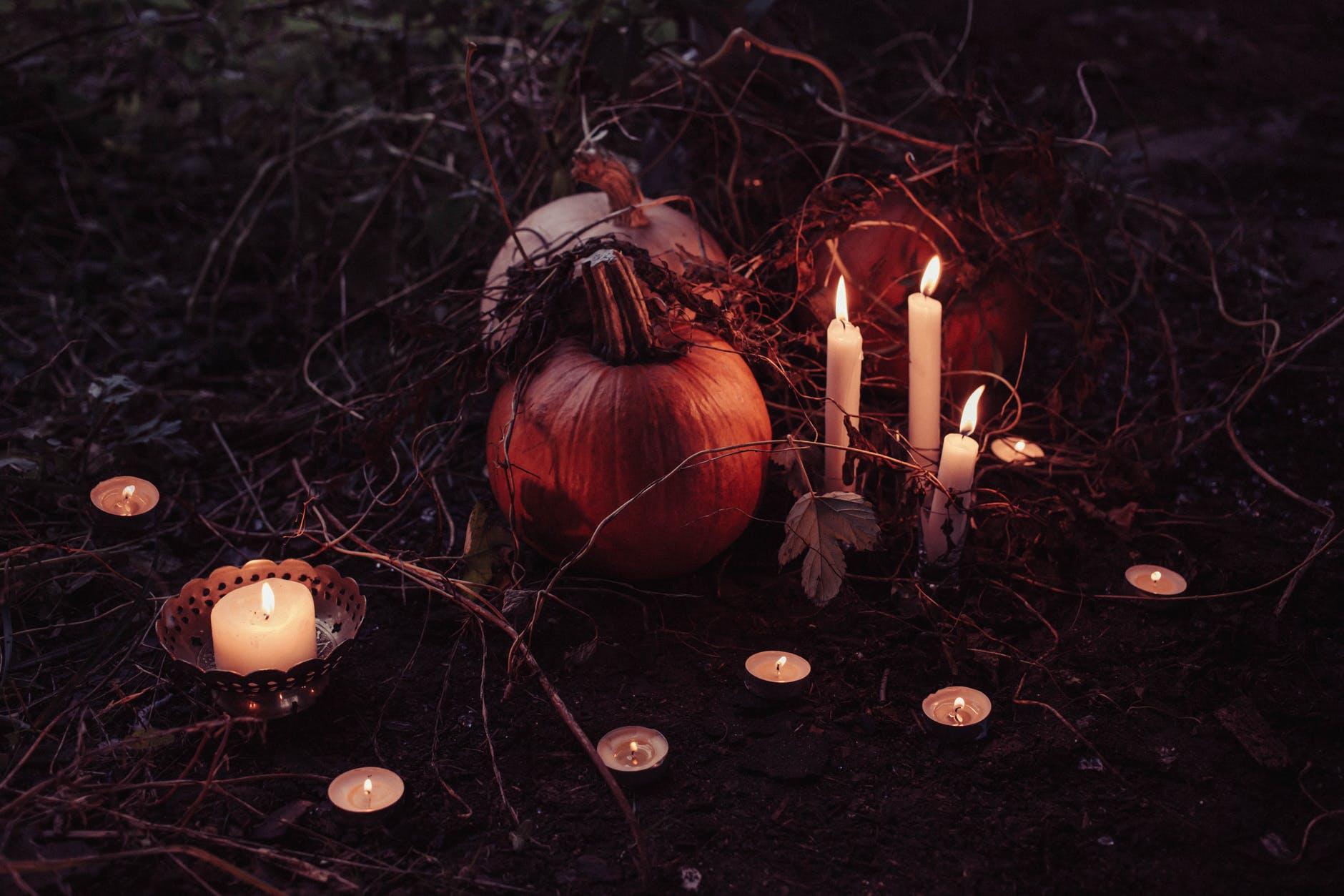 jack o lantern beside candles halloween decor